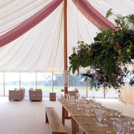 Traditional marquee with ivory pleated linings.