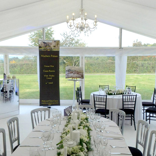 15m Clearspan marquee with hanging lanterns.